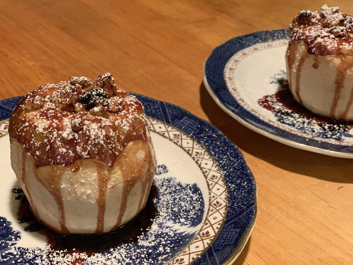 On chilly fall and winter mornings, guests will enjoy our baked apples cooked with granola, maple syrup and cranberry juice. These particular apples were served on blue and white plates