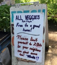 sign giving away veggies