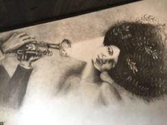 artwork of lady and man blowing trumpet at Hollerhorn Distilling in Naples, just 20 minutes south of the 1795 Acorn Inn