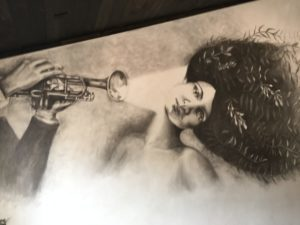 artwork of lady and man blowing trumpet