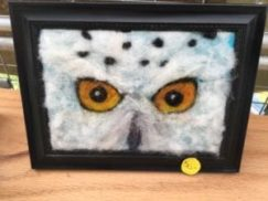 Felt art of bird with yellow eyes... one of the many artistic items for sale at the Lakefront Art Festival in Canandaigua, NY