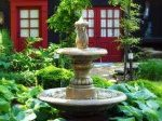 fountain surrounded by shrubbery