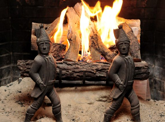 logs in fireplace lit with blazing fire
