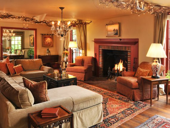 Gathering Room with blazing fireplace, sofas and chairs