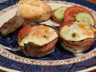 nested eggs with sausage, biscuit and veggies