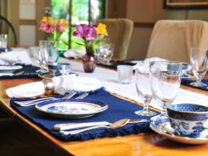 breakfast table set with blue and white dinnerware
