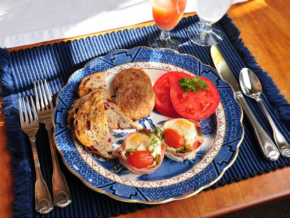 nested eggs, toast, tomatoes for breakfast