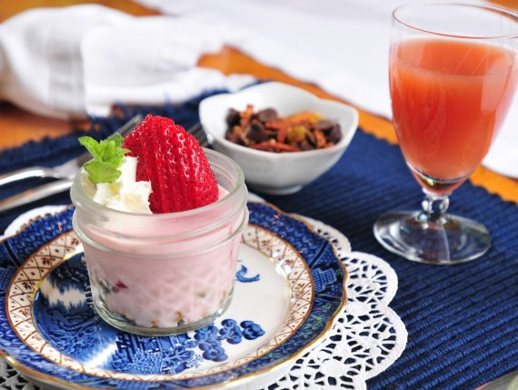 strawberry cheesecake parfait garnished with strawberry