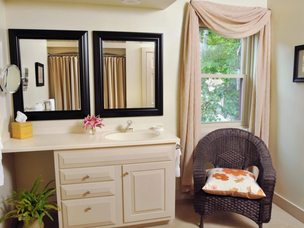 Wilder Room bathroom with vanity and 2 mirrors, wicker chair