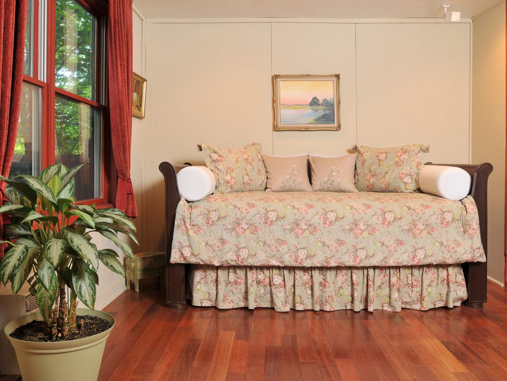 Barn Suite daybed in bedroom with hardwood floors