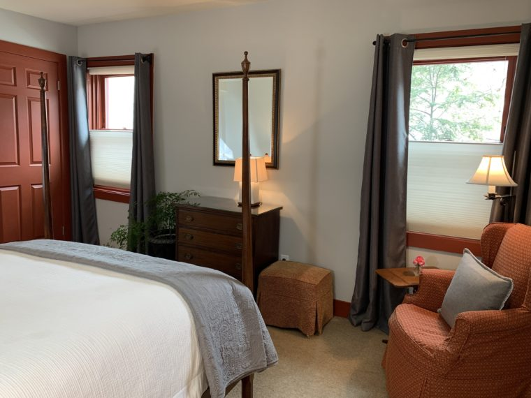 New Wilder bedroom with chair and dresser with lamp