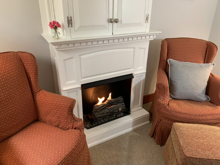Wilder Room fireplace with 2 chairs for relaxing