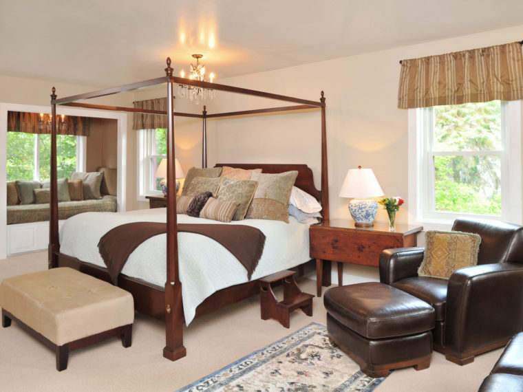 4 poster bed, chair for relaxing, window seat in Bristol Suite