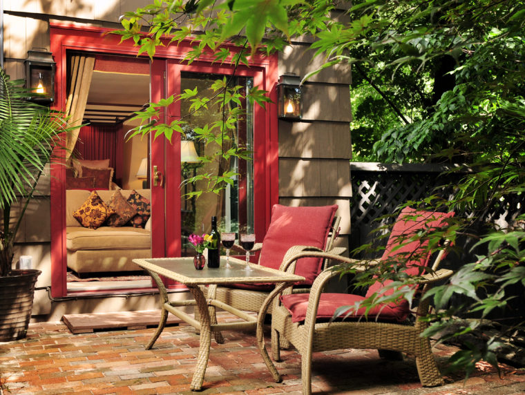 Hotchkiss Room patio with table and chairs for relaxing and wine