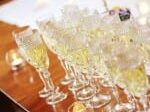 glasses of champagne filled and ready to go for toasting after intimate wedding ceremony at 1795 Acorn Inn Bed and Breakfast in Canandaigua, NY