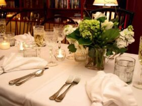 table set for wedding with white flowers, water and wine glasses, silverware and napkins at the 1795 Acorn Inn... the perfect romantic getaway for a intimate wedding