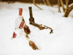 bottles of liquor in chilling in the snow and ready to go
