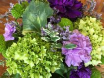 A beautiful flower arrangement of green hydrangea and purple carnations