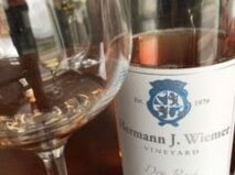 Bottle and glass of Hermann J. Wiemer dry rose wine, located along the Keuka Lake Wine Trail about 40 minutes from the 1795 Acorn Inn Bed and Breakfast