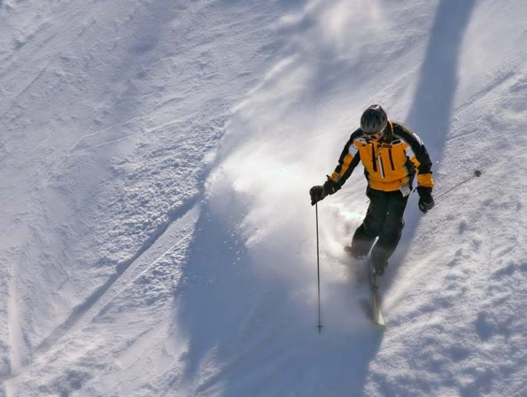person skiing down snowy slope