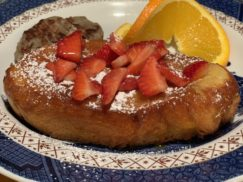 French Toast Creme Brulee garnished with strawberries