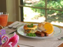 Savory spinach stratta served with sausage and biscuit with the 1795 Acorn Inn B & B's signature cranberry and orange juice