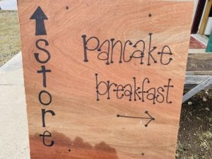 sign pointing to store and to pancake breakfast at Wohlschlegel's Maple Farm in Naples, NY